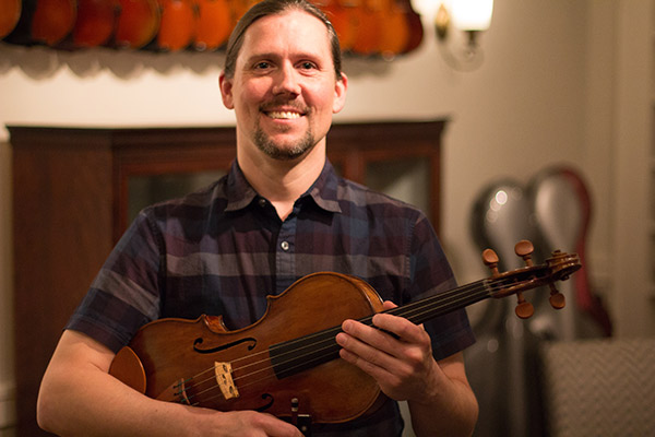 Instructor Todd Markey Holding Viola