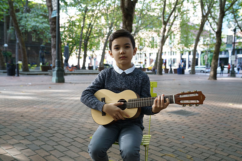 Young guitar student with guitalele